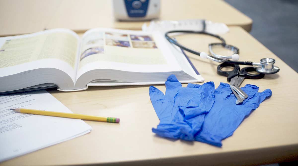 Books and Gloves for healthcare training